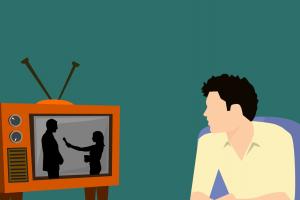 clipart vaneen man die tv kijkt