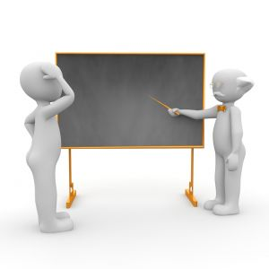 2 figuurtjes aan een schoolbord