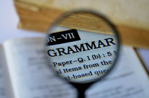 Magnifying glass with the word grammar