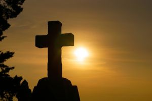 cross with sun in background