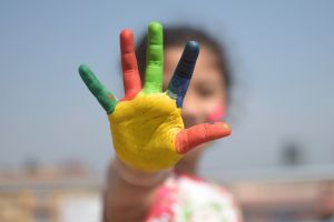girl with painted hand
