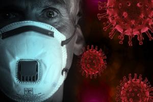 Persoon met mondmasker. Naast de persoon staan een aantal virussen.
