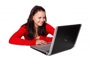 Girl behind a laptop