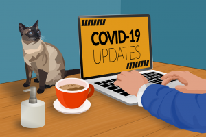 iemand aan een pc met COVID-19 updates