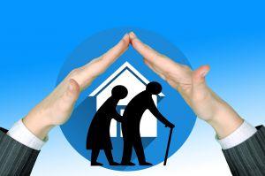 handen vormen een dak boven een icoontje van oude mensen