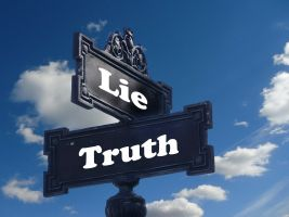 a signpost with lie and truth on it