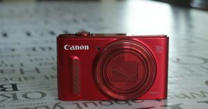 A red compact camera.