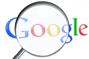 Google viewed with a magnifying glass