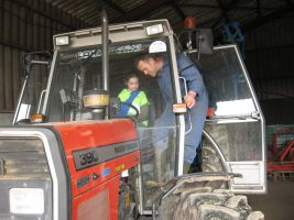 on the tractor with the farmer