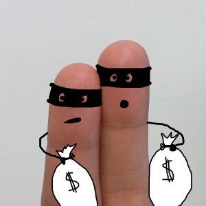 vingers verkleed als overvallers met zakken geld