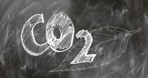 The chemical element CO2 written on a chalkboard.