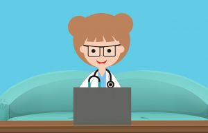 verpleegster aan een computer