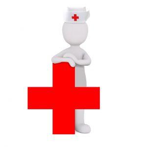 mannetje bij een rood kruis
