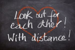 hart met de tekst: look out for each other with distance