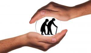 handen die een picto van oude mensen omarmen