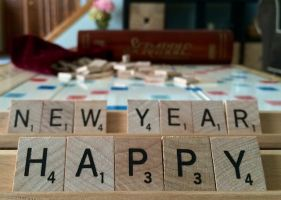 Scrabble blocks with the words happy new year