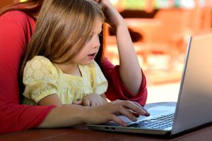 girl plays on the computer