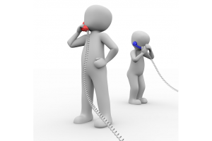 Two people using the telephone