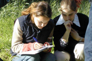 Two students are doing fieldwork in the nature reserve