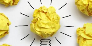 Yellow paper wrinkled into a ball