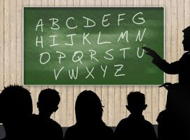 Classroom with blackboard with alphabet
