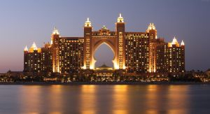 a very large illuminated hotel on a lake