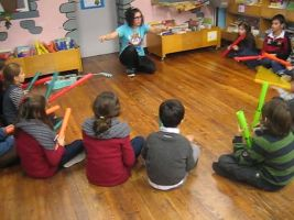 Classroom with children with tree whackers