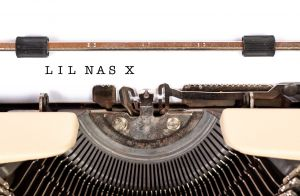 Typewriter with Lil Nas X written on the magazine