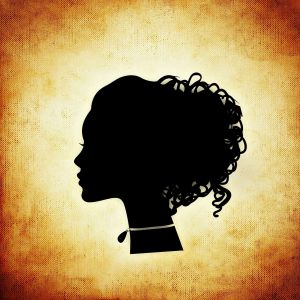 silhouette of a lady with hair put up