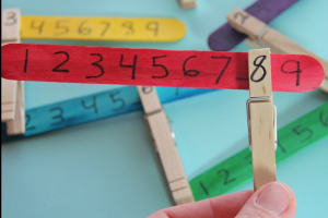 screenshot from video: clothespin with number on number row