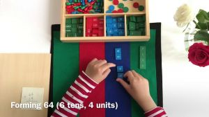 Student who is adding with cubes