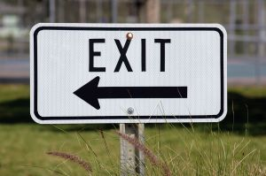 road sign with the word exit