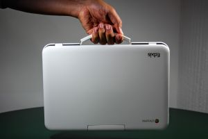 Hand carrying a chromebook