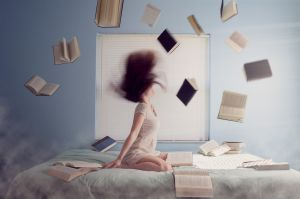 girl on bed with books