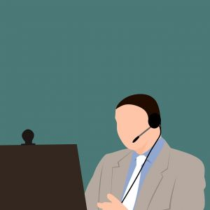 Drawing of a man sitting at his computer with a headset on his head.