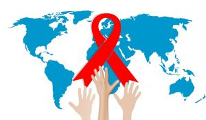 world map with hands reaching for the red ribbon for aids