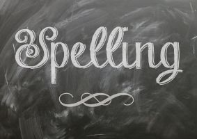 The word spelling is written on a chalkboard