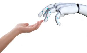 child's hand and robot hand